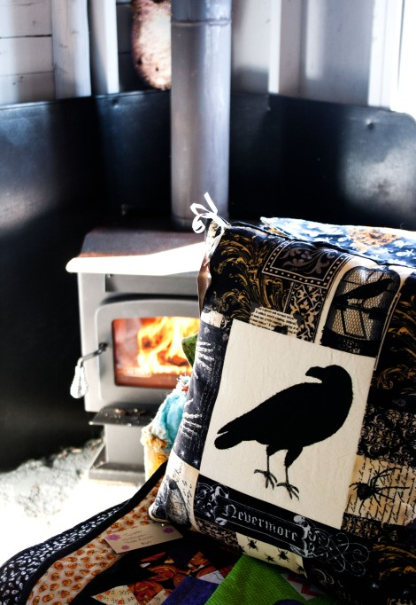 You can't get much cozier than a pillow and a wood stove.